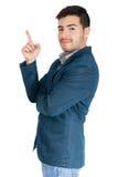 Homem de negócios novo que aponta acima no fundo branco fotos de stock royalty free