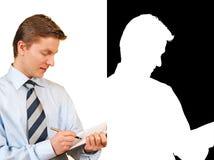 Homem de negócios novo que prende uma prancheta, com alfa Foto de Stock Royalty Free