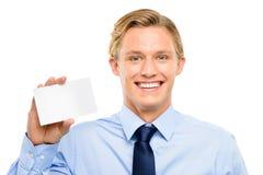 Homem de negócios novo seguro que mantem o cartaz isolado em b branco fotografia de stock