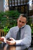 Homem de negócios ocupado Foto de Stock Royalty Free
