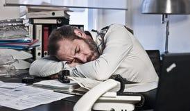 Homem de negócios Overworked Imagem de Stock Royalty Free