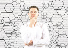 Homem de negócios pensativo com favos de mel Imagem de Stock Royalty Free