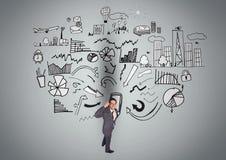 Homem de negócios pensativo com símbolos do negócio contra o fundo cinzento Imagem de Stock Royalty Free