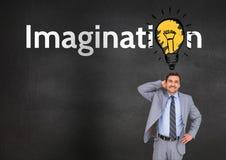 Homem de negócios pensativo que está com texto da imaginação no fundo Foto de Stock Royalty Free