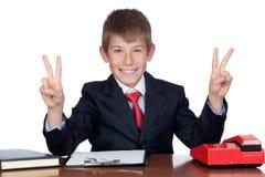 Homem de negócios pequeno no escritório Fotos de Stock