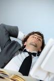 Homem de negócios preguiçoso Foto de Stock Royalty Free
