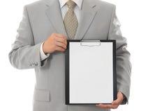 Homem de negócios, prendendo a folha de papel com espaço vazio fotos de stock