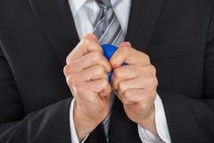 Homem de negócios Pressing Stress Ball fotografia de stock royalty free