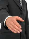 Homem de negócios pronto para agitar as mãos Imagem de Stock