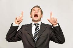 Homem de negócios que aponta acima foto de stock royalty free