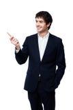 Homem de negócios que aponta com a pena no fundo branco Fotografia de Stock