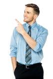 Homem de negócios que aponta em algo Foto de Stock Royalty Free