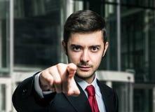 Homem de negócios que aponta seu dedo a você foto de stock royalty free