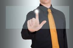 Homem de negócios que aponta a um ecrã táctil vazio Imagens de Stock Royalty Free