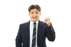 Homem de negócios que aprecia o sucesso Foto de Stock Royalty Free