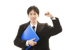 Homem de negócios que aprecia o sucesso Imagem de Stock Royalty Free