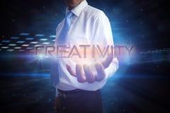 Homem de negócios que apresenta a faculdade criadora da palavra imagens de stock royalty free