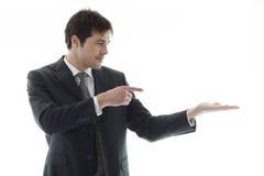 Homem de negócios que apresenta o produto Foto de Stock Royalty Free