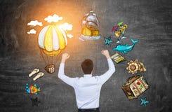 Homem de negócios que bate acima ícones do curso Fotos de Stock Royalty Free