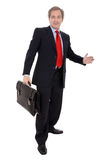 Homem de negócios que carreg uma pasta Imagens de Stock