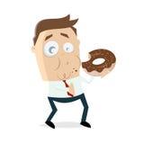 Homem de negócios que come uma filhós deliciosa Imagens de Stock