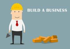 Homem de negócios que constrói um negócio novo Fotografia de Stock Royalty Free