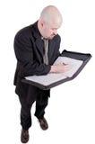 Homem de negócios que consulta sua agenda Imagem de Stock Royalty Free