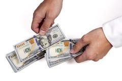 Homem de negócios que conta o dinheiro Foto de Stock