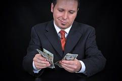 Homem de negócios que conta o dinheiro Imagens de Stock Royalty Free
