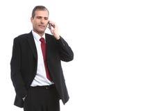 Homem de negócios que convida o telefone móvel Fotografia de Stock Royalty Free