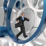 Homem de negócios que corre no círculo Imagens de Stock Royalty Free