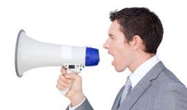 Homem de negócios que dá instruções com um megafone Imagens de Stock Royalty Free