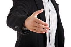 Homem de negócios que dá a mão fotos de stock royalty free