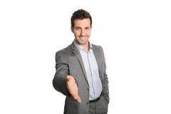 Homem de negócios que dá a mão para o aperto de mão Imagens de Stock Royalty Free