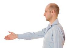 Homem de negócios que dá a mão para o aperto de mão fotografia de stock royalty free