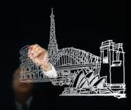 Homem de negócios que desenha a grande arquitetura das construções imagens de stock royalty free
