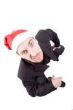Homem de negócios que desgasta o chapéu de Santa fotos de stock