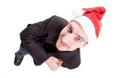 Homem de negócios que desgasta o chapéu de Santa fotografia de stock