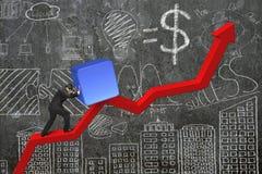 Homem de negócios que empurra o bloco no ponto de partida da carta da tendência com doo Foto de Stock Royalty Free