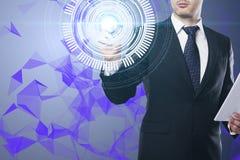 Homem de negócios que empurra o botão digital imagem de stock royalty free