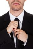 Homem de negócios que endireita seu laço Foto de Stock