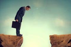 Homem de negócios que enfrenta um desafio Fotografia de Stock Royalty Free