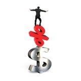 Homem de negócios que equilibra no símbolo dos por cento e no sinal de dólar vermelhos Imagem de Stock Royalty Free