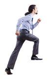 Homem de negócios que escala a escada virtual Foto de Stock Royalty Free