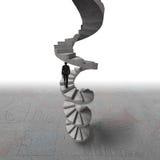 Homem de negócios que escala a escadaria espiral concreta Imagens de Stock Royalty Free