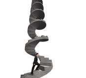 Homem de negócios que escala a escadaria espiral concreta Imagens de Stock