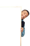 Homem de negócios que esconde atrás da bandeira Imagem de Stock Royalty Free