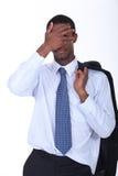 Homem de negócios que esconde sua face Foto de Stock Royalty Free