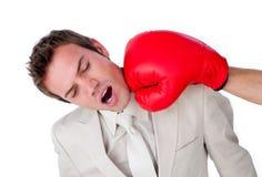 Homem de negócios que está sendo batido com uma luva de encaixotamento Imagens de Stock Royalty Free
