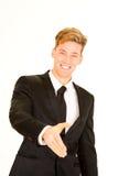 Homem de negócios que estende sua mão foto de stock royalty free